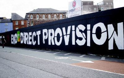 Mural stating 'End Direct Provision'